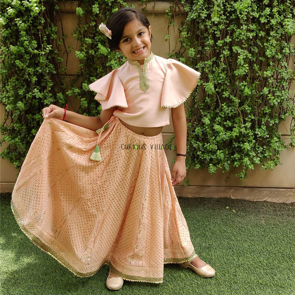 Peach color chikankari lehnga with bell sleeved crop top